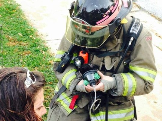 A chinchilla is given respiratory treatment at the scene of a fire Tuesday morning in Dover.