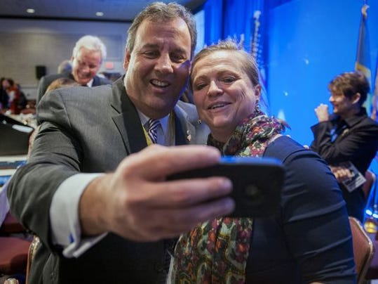 Gov. Chris Christie takes a cellphone photo with National Governors Association staffer Lily Kersh during the NGA's winter meeting in Washington in February. Today he's in Nashville for the summer meeting. (AP file photo)