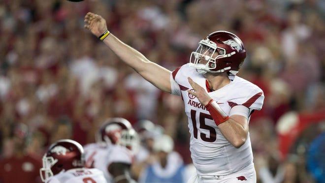 Arkansas quarterback Cole Kelley (15) passes against Alabama during Saturday's game at Bryant-Denny Stadium.
