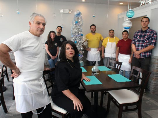 Owners Joe and Christine Mercadante (left) with family and wait staff at the new location of Joe's Pizzeria on Route 35 in Wall..
