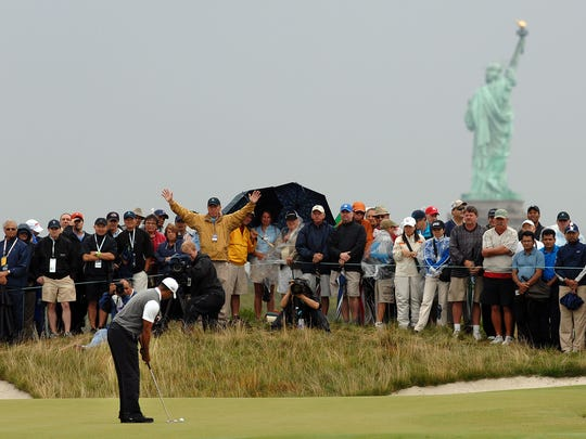 Tiger Woods and the Statue of Liberty during a PGA