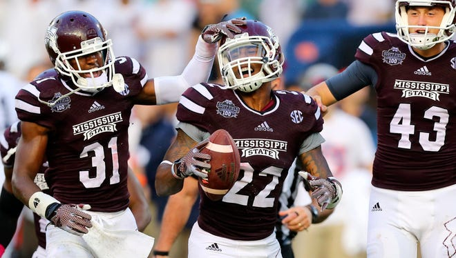 Mississippi State linebacker Matthew Wells (22) and teammate Tolando Cleveland celebrate Wells' fumble recovery against Auburn on Oct. 11.