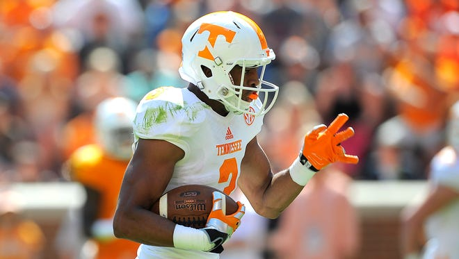 Josh Malone finds an opening and takes it in for a touchdown as the University of Tennessee plays in the Orange and White game at Neyland Stadium. Saturday April 12, 2014, in Knoxville, TN.