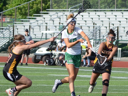 Cranbrook's Sophia Milia splits two Mercy defenders
