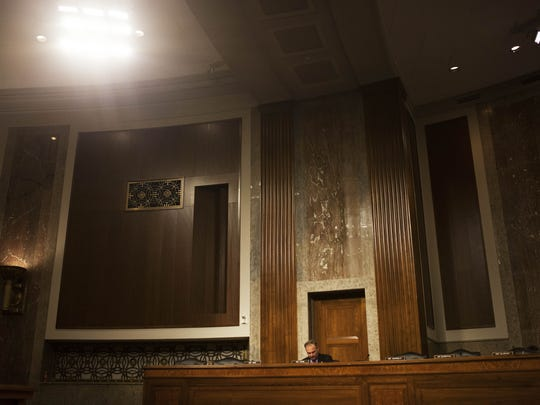 Sen. Tim Kaine prepares his questions prior to a hearing with Chuck Hagel, President Obama's nominee for Secretary of Defense, on Jan. 31, 2013. Because Kaine is a freshman senator, he was one of the last to ask questions of Hagel during the daylong hearing.