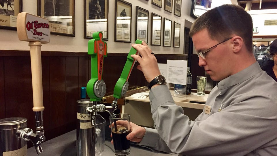 Michael C. pours a pint for a customer at Purdue's