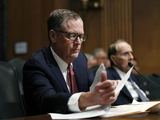 In this March 14, 2017, file photo, United States Trade Representative-nominee Robert Lighthizer, foreground, looks at documents during his confirmation hearing on Capitol Hill in Washington.