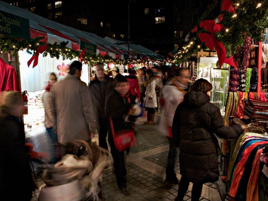 Shoppers rush home with their treasures at the Columbus Circle Holiday Market.