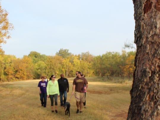 Fall color frames hikers Saturday near Cedar Creek.