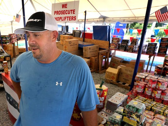Jason Dobbs talks about working the a firework stand for a few years and how much he enjoys talking with people as they shop for their 4th of July fireworks. Photo taken on Thursday, June 25, 2015.