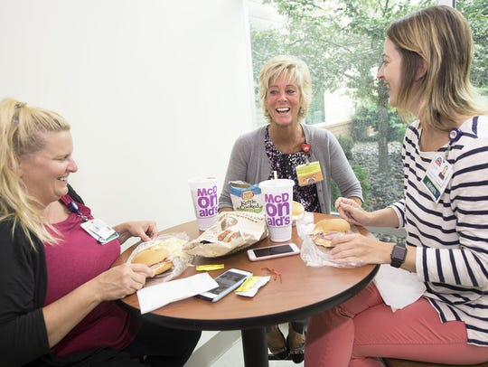 Misty Hershey, left, Amy Burton and Nichole Earley enjoy lunch on Monday, July 23, 2018, in The Lunch Box Cafe inside Fulton County Medical Center.