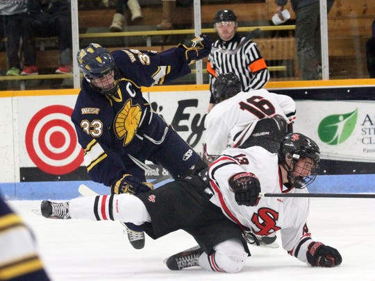 Wausau West's Adam Parsells, left, was named a first team all Wisconsin Valley Conference and all-state defenseman for the second straight season this year.