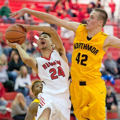 Bucyrus' Noah Johnson attempts to shoot past the Northmor