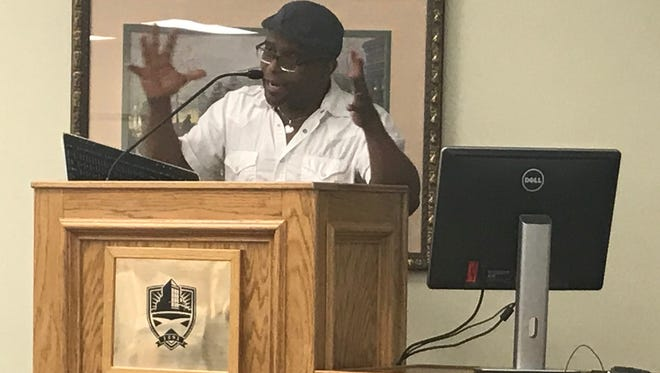 """An animated Tyehimba Jess peaks about creating his Pulitzer Prize-winning book of poems, """"Olio,"""" at Hardin-Simmons University's Lawrence Clayton Poets & Writers Speaker Series on Friday, April 6, 2018."""