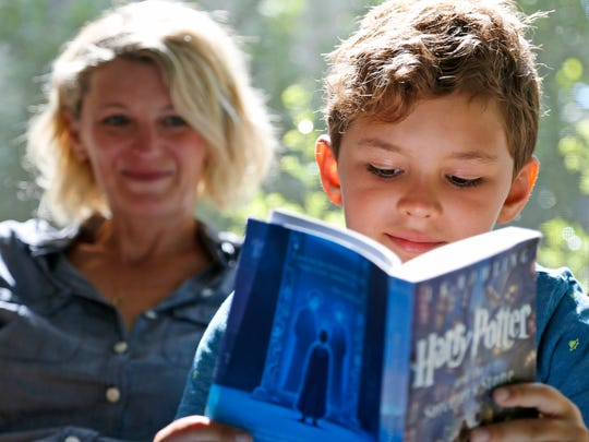 """Theo Galkin, 8, rereads a favorite part of """"Harry Potter"""
