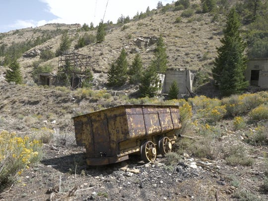 This Aug. 28, 2018, photo shows a rail car at an abandoned mine in Hiawatha, Utah. Many mines are like a time capsule, complete with rail cars and tools, and lined with intricately shaped stones.