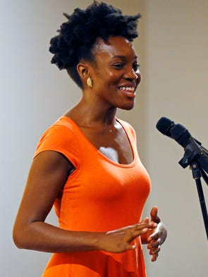 """Rachel Egboro tells a story during the Arizona Republic live storytelling event themed """"Phoenix, Our City, Our Stories,"""" on Wednesday, Aug. 27, 2014 at The Newton in Phoenix."""