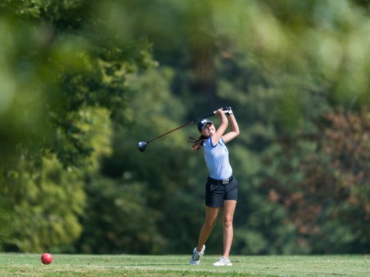 Memorial's Mallory Russell tees off at hole nine during