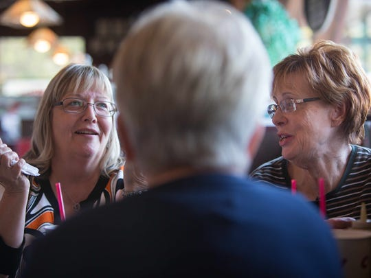 Robbin Luff of Newark (left) and Linda Holland (right) of Wilmington talk about Vice President Joe Biden's announcement that he will not be running for President at the Charcoal Pit on Concord Pike.