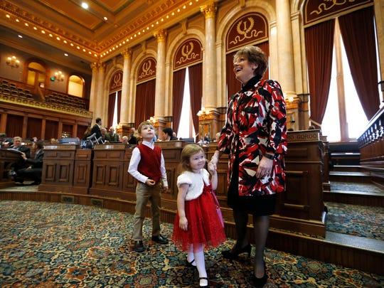 Rep. Linda Upmeyer shows her grandchildren Cooper Upmeyer-Evers,