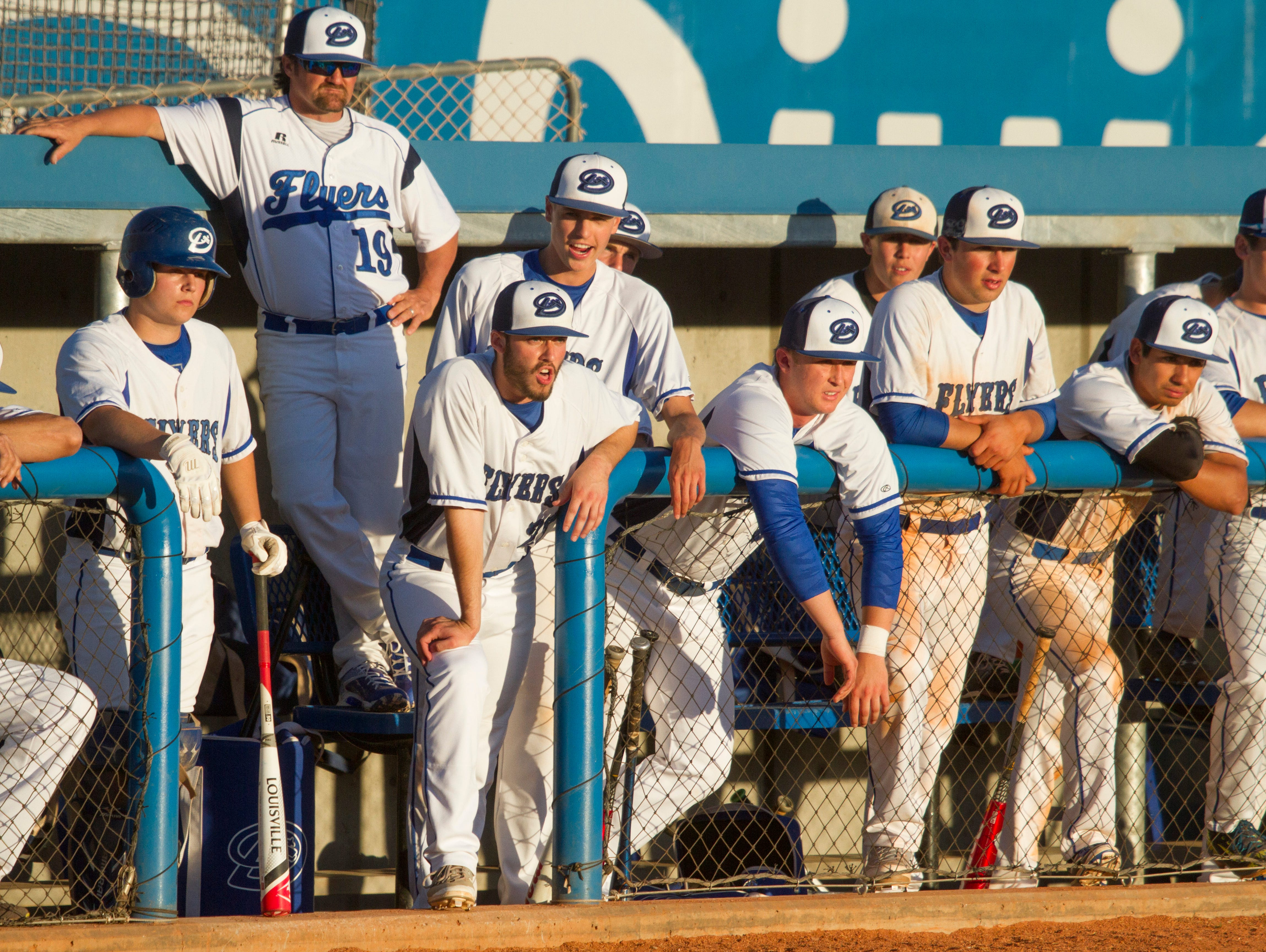 Dixie players and coaches look on during the Flyers come-from-behind victory over the Cedar Redmen Tuesday night. Hobbs Nyberg drove in the game-winning run with a blast to deep left field.