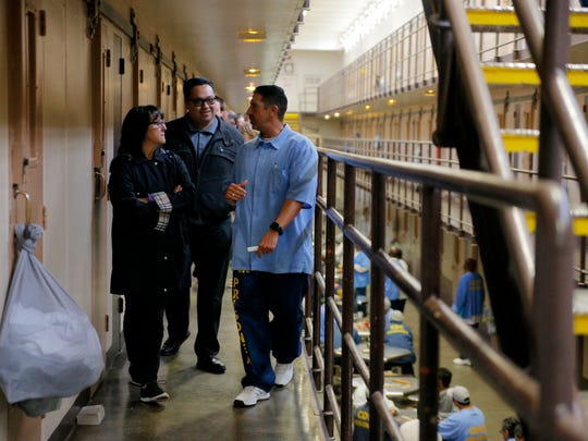 An inmate takes Palm High faculty and staff on a tour of cells at the Correctional Training Facility prison in Soledad.