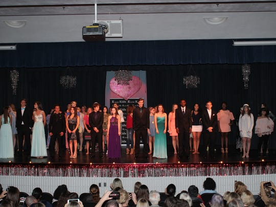The teen models of the sixth annual K is for Kids Teen Fashion Show take a curtain call.