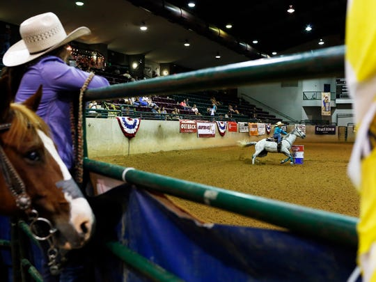 Barrel racing at the Coliseum on the Mississippi State Fairgrounds is one of many events held where concessions are sold. The concessions contract is currently being contested.