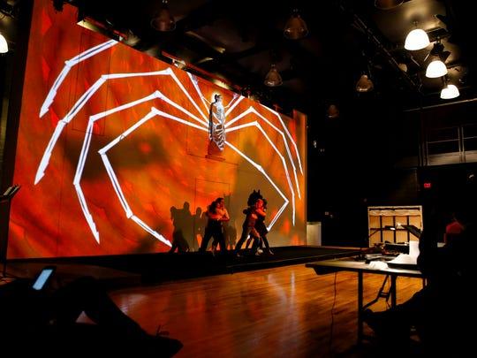 Performers rehearse the Cincinnati Opera's production