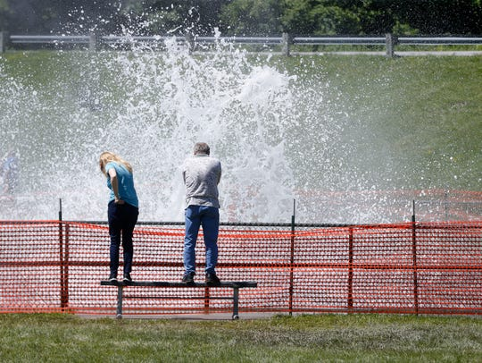 Marilyn and Marty Mauk of Des Moines look on as water