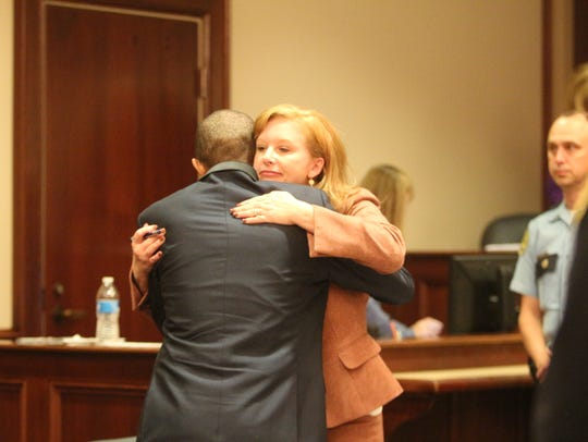 Jacobi Pender embraces his attorney Stephanie Ritchie