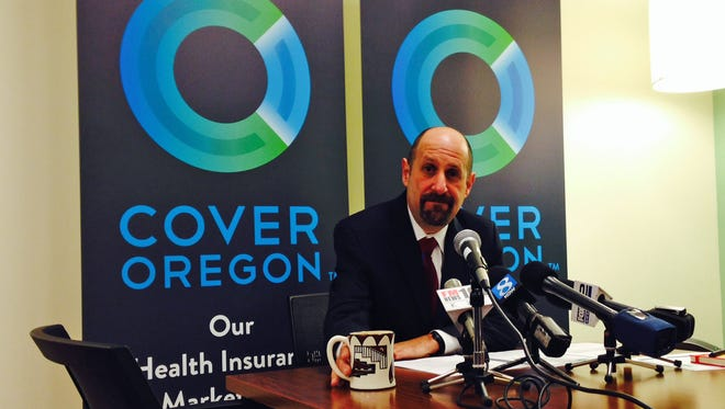Dr. Bruce Goldberg, acting head of Oregon's troubled health insurance exchange, prepares for a news conference on Dec. 10 at Cover Oregon's headquarters in Durham, Ore.