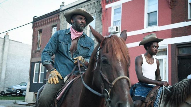 "Idris Elba, left, and Caleb McLaughlin in Ricky Staub's ""Concrete Cowboy."""