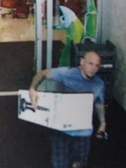 One of two suspects in theft of two expensive vacuums