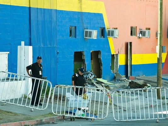Police officers investigate the scene in
