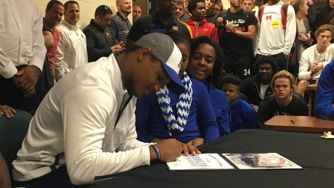 Maryville linebacker T.D. Blackmon signs to play at Air Force Academy on Wednesday at Maryville High School.