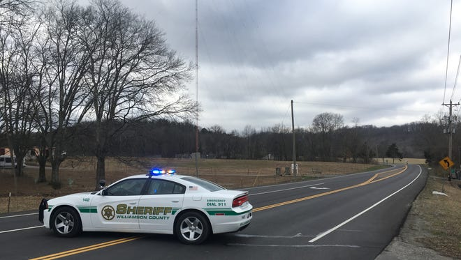 A Williamson County Sheriff's Office cruiser blocks West Main and Horton Lane following a crash that killed 2 people on Carters Creek Pike Sunday, Feb. 5, 2017