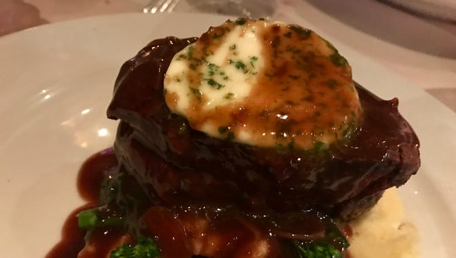 Filet mignon with roasted-garlic compound butter from Twisted Vine Bistro.