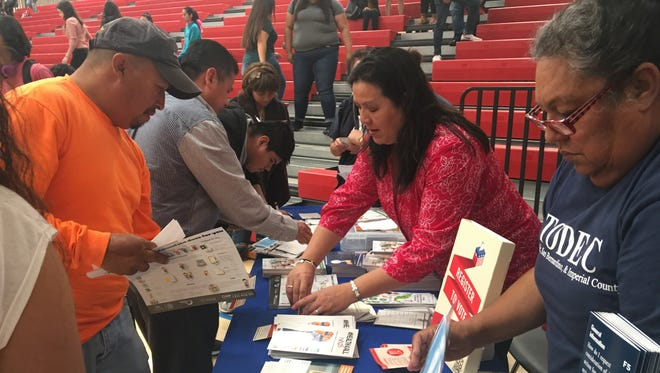 Volunteers from TODEC Legal Center and the Mexican Consulate in San Bernardino hand out information about immigration policies and legal rights.