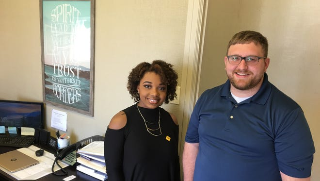 Christopher Youth Center and YAC emergency services case manager Tatyana Dace meets with pastor Richard Blue from Lea Joyner United Methodist Church . Blue blessed the new youth facility on Tuesday.