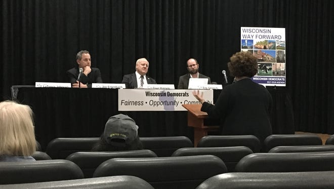 From left, state Sen. Jon Erpenbach, state Sen. Dave Hansen and state Rep. Eric Genrich listen to testimony from Brown County Aging and Disability Resource Center Director Devon Christianson Saturday.