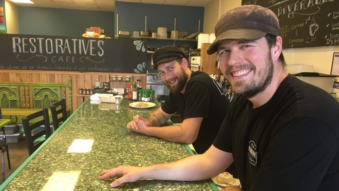 Brothers Tim, right, and Jay Gillmore own Restoratives Cafe in Estero.