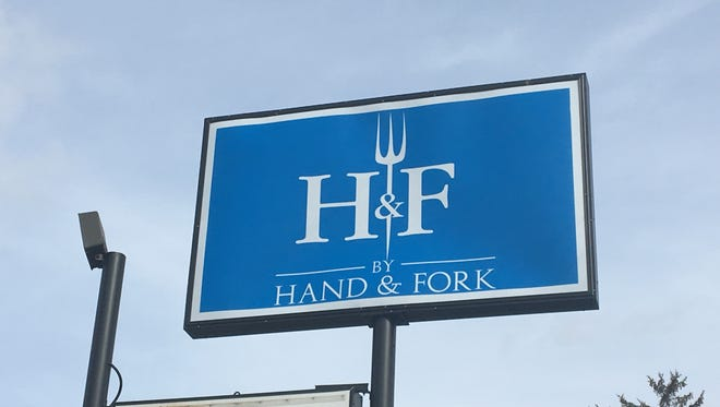 Sign for By Hand & Fork, a restaurant that opens March 5 and will serve comfort food.