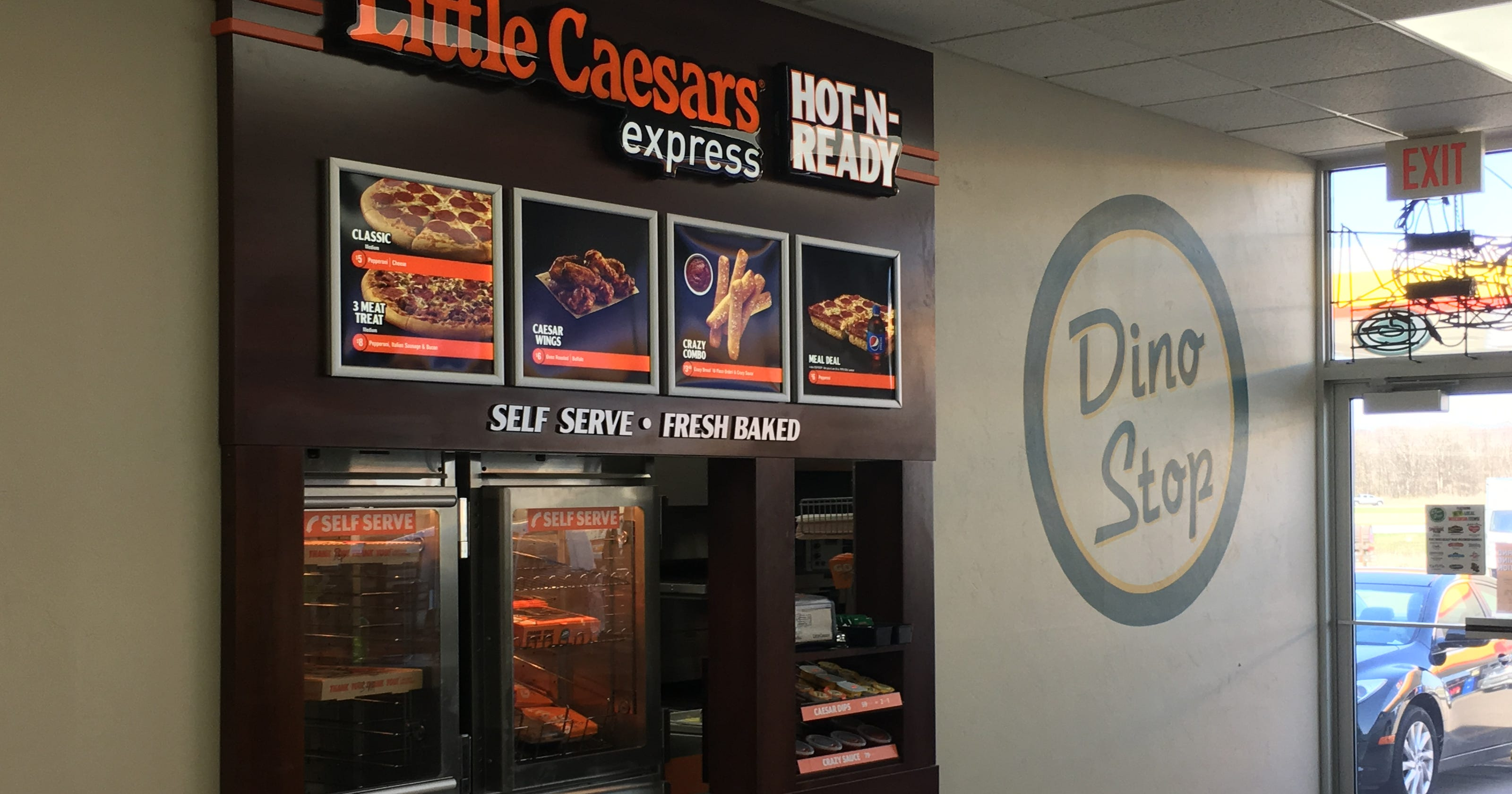 Outside Green Bay Dino Stop Introduces Little Caesars Express Concept