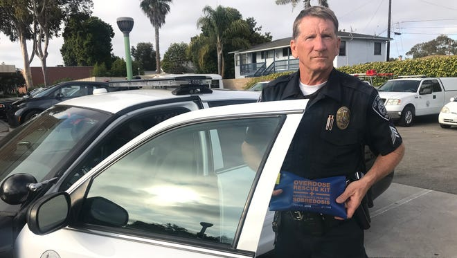 Sgt. Chris Graham, of the Port Hueneme Police Department, displays an emergency kit officers now carry to counteract opioid overdoses.