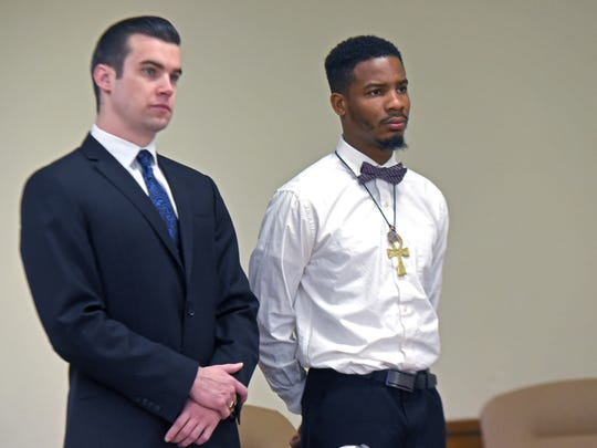 Quinzelle Bethea (right), accompanied by public defender Tim Dalton, learned at an April 18 hearing in Camden County Superior Court that all charges filed against him after being stopped in November by county police Officer Douglas Dickinson had been dropped.