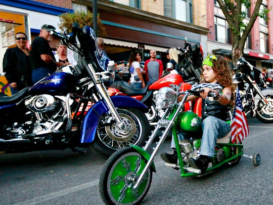 Muner Ashayer, 5, of Gettysburg, rides down Market Street during the 23rd Annual York Bike Night in York City, Friday, Sept. 29, 2017. Dawn J. Sagert photo