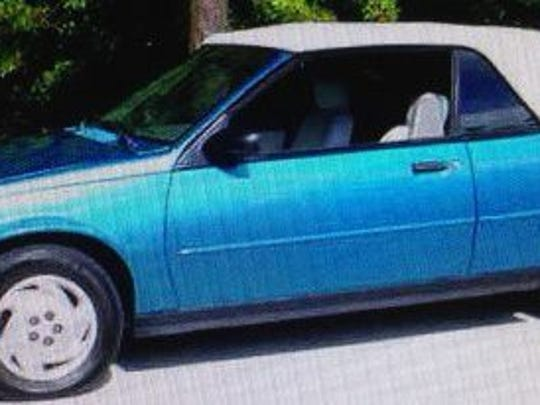 Bill Williams was seen leaving in a bright blue 1994 Chevrolet Cavalier convertible.