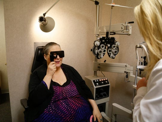Karen Slessor of Reinbeck, Iowa, gets her eyes checked Wednesday, May 3, 2017 during an appointment at Wolfe Eye Clinic in Cedar Falls, Iowa.