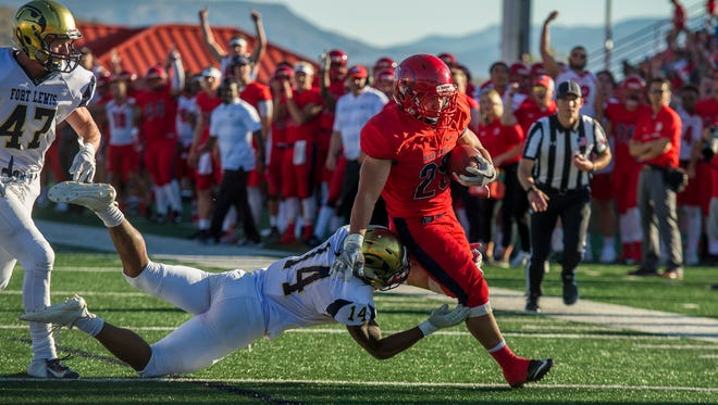 Dixie State University running back Sei-J Lauago (25) runs close to the end zone against Fort Lewis College at DSU Saturday, September 8, 2018.